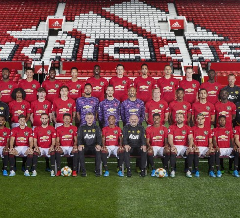 MANCHESTER, ENGLAND - AUGUST 15: (EDITORS NOTE: Image has been digitally altered) The Manchester United squad (Back Row L-R: Physio Richard Merron, Coach Charlie Owen, Timothy Fosu-Mensah, Marcos Rojo, Aaron Wan-Bissaka, Mason Greenwood, Paul Pogba, Harry Maguire, Chris Smalling, Nemanja Matic, Scott McTominay, Axel Tuanzebe, Coach Richard Hawkins, Coach Paul Brand. Middle Row L-R: Dr Steve McNally, Coach Michael Carrick, Coach Kieran McKenna, Tahith Chong, Jesus Gamez, Victor Lindelof, Sergio Romero, David de Gea, Lee Grant, Phil Jones, Anthony Martial, Diogo Dalot, Eric Bailly, Goalkeeping Coach Richard Hartis, Coach Emilio Alvarez, Kit Manager Alec Wylie. Front Row L-R: Alexis Sanchez, Angel Gomes, Daniel James, Juan Mata, Jesse Lingard, Manager Ole Gunnar Solskjaer, Ashley Young, Assistant manager Mike Phelan, Marcus Rashford, Luke Shaw, Andreas Pereira, Fred, Brandon Williams) pose for the annual team photo at Old Trafford on August 15, 2019 in Manchester, England. (Photo by Manchester United/Manchester United via Getty Images)