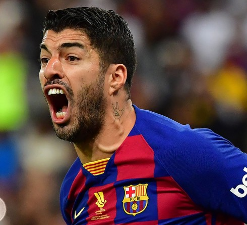 Barcelona's Uruguayan forward Luis Suarez reacts during the Spanish Super Cup semi final between Barcelona and Atletico Madrid on January 9, 2020, at the King Abdullah Sport City in the Saudi Arabian port city of Jeddah. - The winner will face Real Madrid in the final on January 12. (Photo by Giuseppe CACACE / AFP) (Photo by GIUSEPPE CACACE/AFP via Getty Images)