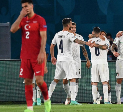 Italy's forward Lorenzo Insigne (C) is congratulated for scoring his team's third goal during the UEFA EURO 2020 Group A football match between Turkey and Italy at the Olympic Stadium in Rome on June 11, 2021. (Photo by Filippo MONTEFORTE / POOL / AFP) (Photo by FILIPPO MONTEFORTE/POOL/AFP via Getty Images)