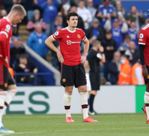 LEICESTER, ENGLAND - OCTOBER 16: Harry Maguire of Manchester United reacts after conceding during the Premier League match between Leicester City and Manchester United at The King Power Stadium on October 16, 2021 in Leicester, England. (Photo by Alex Pantling/Getty Images)